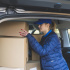 female-courier-with-boxes-in-car_23-2147767801