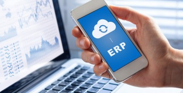 ERP app on smartphone screen connecting data with cloud computing